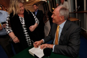Ken signs a book for a fan. Photo Hattie Miles