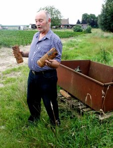 Farmer Dirk with some of shells he's ploughed up